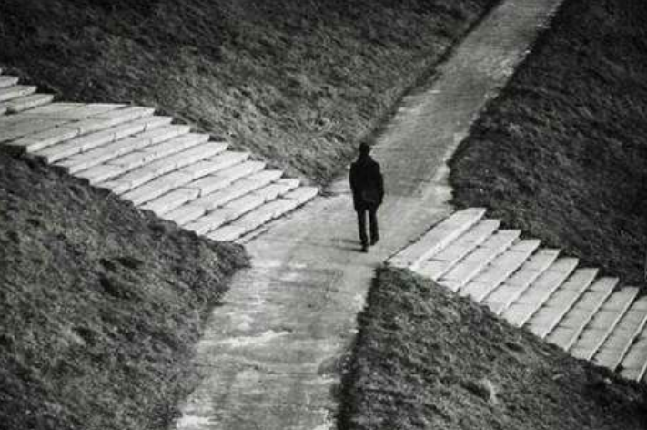 a man standing in 4 way path. Which is the best way to go make a choice, just like AB testing.